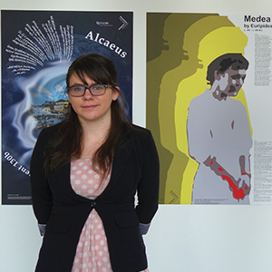 A student standing in front of a poster in the exhibit.