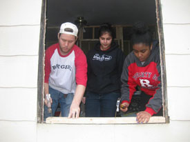 Rutgers students (from left) Keith Freedman, Priyanka Desai and Yumiko Remouns rehab a home in Beards Fork, West Virginia