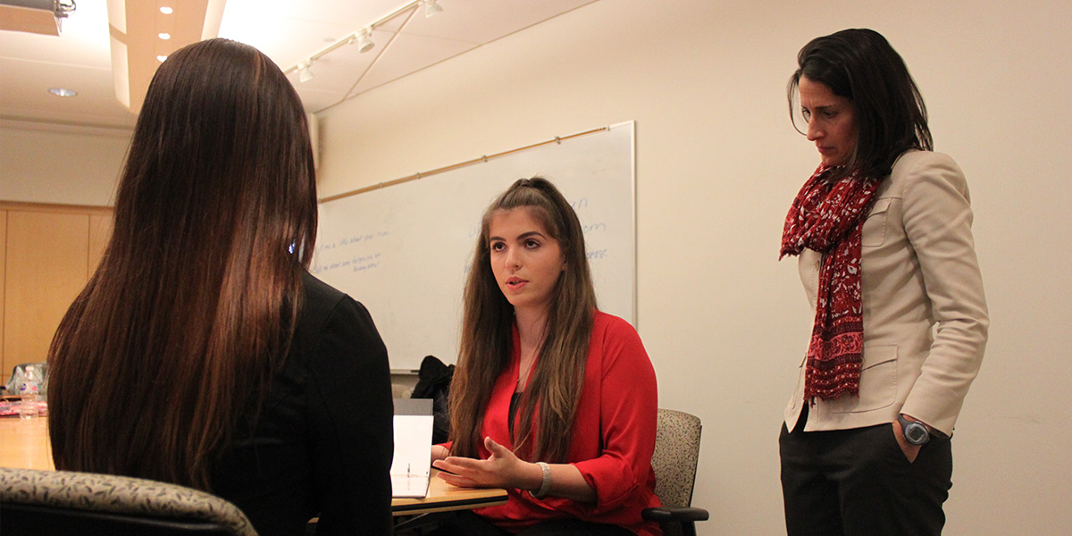 Jessica Joines, director of the new Genetic Counseling Master's Program, observes her students as they act out a role-playing exercise.